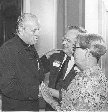 Fr. Robert Drinan with Mr. and Mrs. Moss
